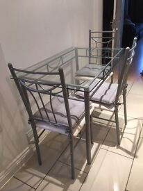4-seater Glass Table & chairs
