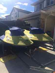 Matching pair of Seadoos and trailer for Sale