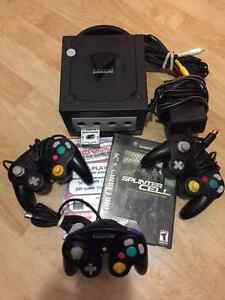 GameCube Black with three controllers and games