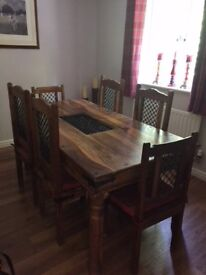 Sheesham Dining Table & 6 chairs. 1800 mm x 900 mm. V Good condition. Matching sideboard if wanted.