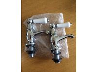Set of bathroom sink taps - chrome and white