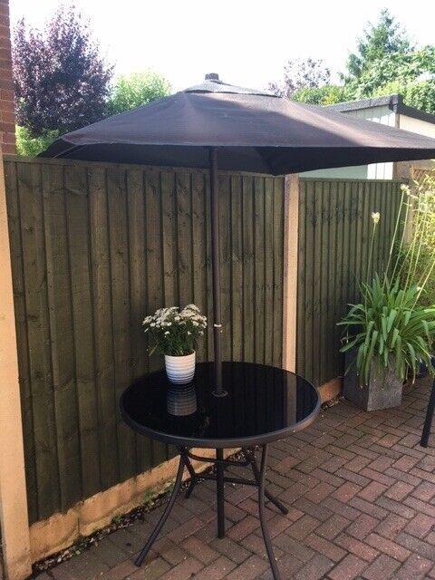 f05e246373 Round Black glass top garden table & umbrella.   in Burton Joyce,  Nottinghamshire   Gumtree