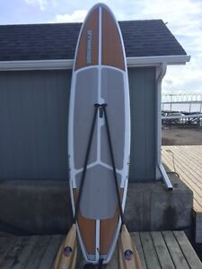 2 Paddle boards (solid) in excellent shape 1 yr old.