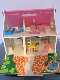 Wooden dolls house with wooden furniture. Excellent condition