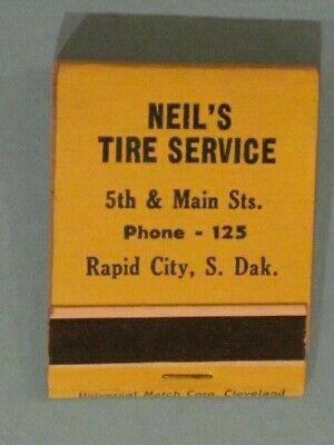 **** Neil's Tire Service Matchbook - Rapid City, S. Dak.  Phone - 125