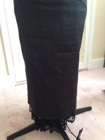 Black satin skirt with pleat detail and lace