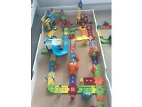 Practically new 50 piece Vtech fire engine / police engine track and vehicles with box