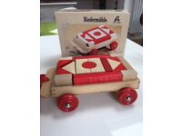 Pull-along wooden toy wagon with wooden blocks