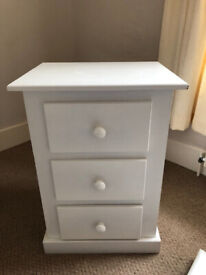 White modern bedside table, three drawers, matching pair available, condition good.