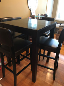 Pub style table with 4 leather chairs