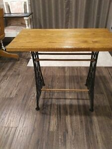 Beautiful oak top table on cast iron legs