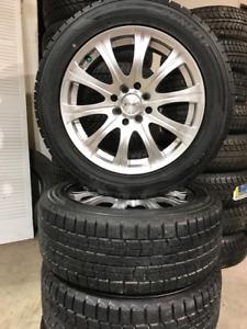 MINI COOPER - 205/55/16 Dunlop Graspic Winter Tires on Alloys