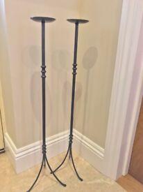 Pair of floor standing candle holders
