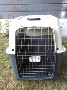 Dog kennel with mattress and with attachable rollers