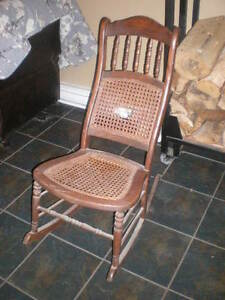 Antique Solid Wooden Rocking Chair With Cane Seat And Back