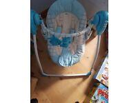 Blue baby swing