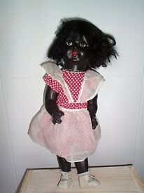"""14"""" black doll with original clothing"""