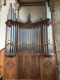 Antique ornate organ pipes and surround from church