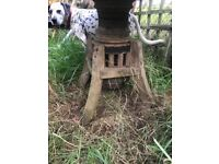Garden table made from an old wagon wheel with metal band. Beautiful item rare to find.