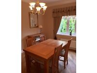 Solid Oak Extendable Dinning Room Table and Four chairs and solid oak side cabinet