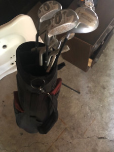 Assorted golf clubs and bag.