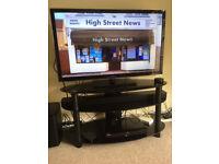 """Panasonic 42"""" TV , Roth Soundbar, and stand"""