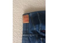 Levis super skinny mid-blue denim jeans, size 28