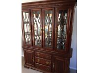 Wooden dresser with lit glass cabinet and drawers