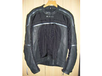 motorcycle helmet, jacket and overtrousers