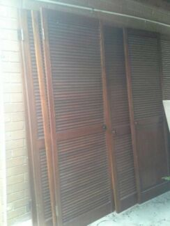 Solid Meranti timber louvred doors stained - $50 each