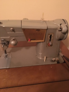 Vintage Singer sewing machine and table