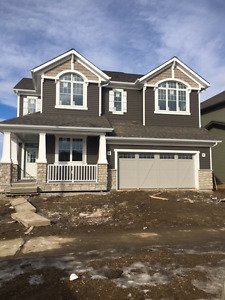 BEAUMONT 2 1/2storey, TRIPLE tandem garage, backing Golf Course!
