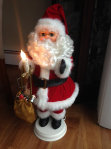 Moving Santa with lighted candle
