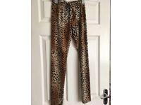Leopard print leggings - never worn - soft material. Size 12.
