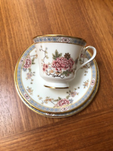 Royal Doulton footed cup and saucer along with 6 5/8