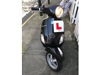Black Piaggio Vespa 125cc Scooter / Moped