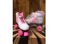 GIRLS RIO ROLLERS SKATES SIZE 7 HELMET AND ACCESSORIES