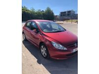 Good runner Peugeot 307 red colour, new break pads and water pump.