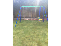 Swing set with two seat glider