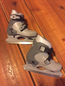 Childs Adjustable Skates and Bauer Helmet with Cage