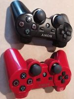 Two PS3 Dual Shock 3 Controllers (1 red, 1 black)