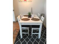 White Extendable IKEA Dining Room Table and 4 Chairs