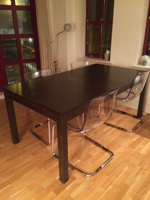 Dining table 4 stylish transparent chairs BJURSTA Extendable