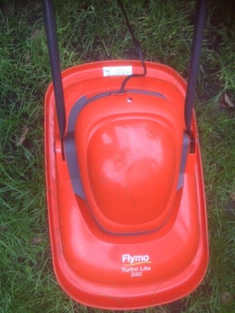 Flymo electric lawn mower, hovering type, great for small gardens, used one year moving to Canada