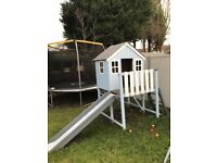 Garden wooden playhouse with a slide