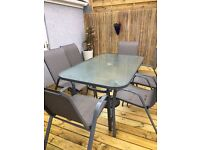 FANTASTIC GLASS PATIO table and 6 chairs, as new , only 7 months old. great saving on new
