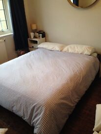 Wooden Ikea bed and mattress