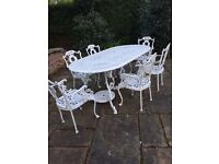 Garden table and 6 chairs in white cast iron