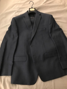 Brand new men's Michael Kors suit size 42s