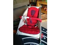 Mamas and papas bouncy chair red